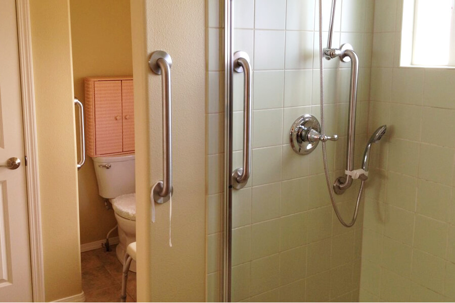 Walk-in shower modification with grab bars.