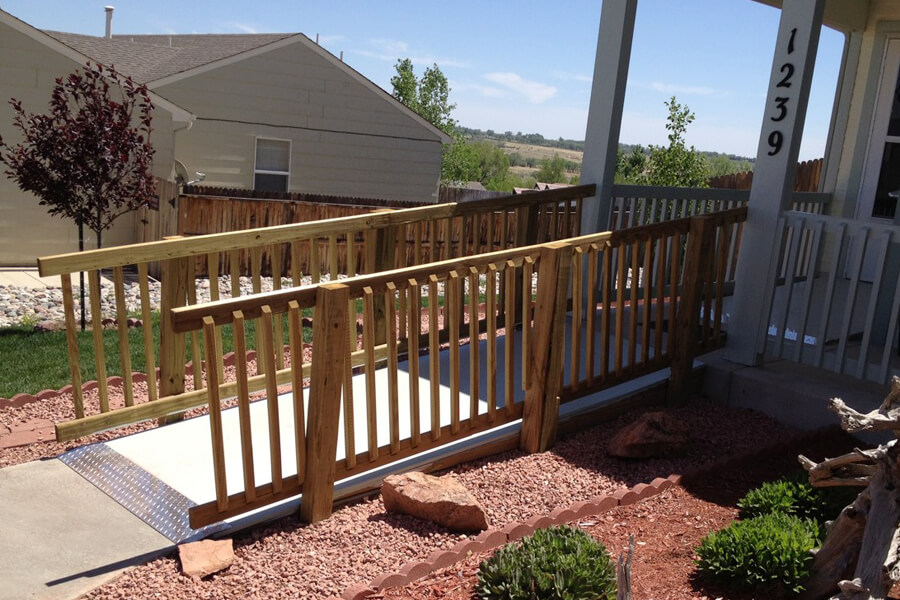 Exterior wheel chair ramp to complement landscaping.