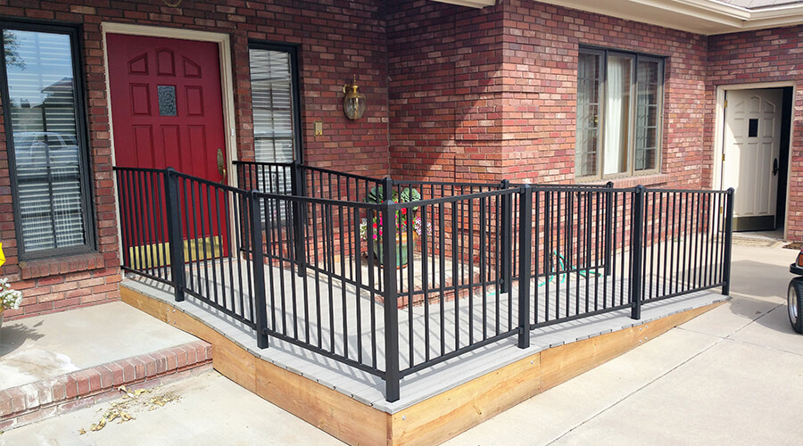 Wheel chair ramp with metal rails on a brick home in Colorado Springs, CO.